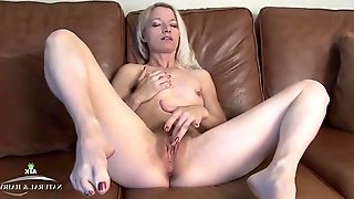 Pretty girl with a marvelous bush rubs her clit