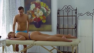 Sensual teen Brianna gives a blowjob and gets fucked on the massage table